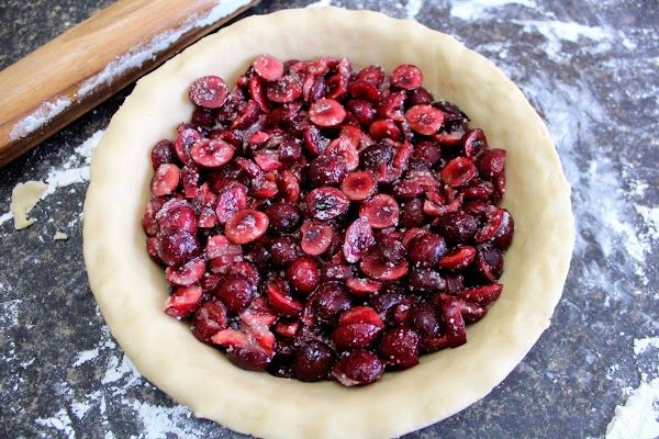 Cherry filling poured into pie crust.