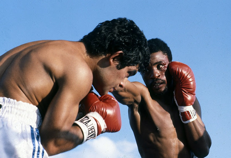 File photo of Peter Mathebula of South Africa, Santos Laciar of Argentina during the bout in Soweto, South Africa.