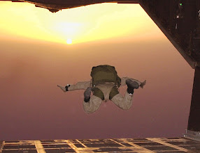 Photo: AHMED AL JABER AIR BASE, Southwest Asia -- Staff Sgt. David Risnear, a combat controller and HALO jumpmaster with the Air Force Special Operations Detachment here, catches some air after jumping from the back of an MC-130E Combat Talon II.  The HALO (High Altitude, Low Open) jump included members of the 332d Expeditionary Securit Forces Squadron, AFSOD, and others from Camp Doha. (USAF Photo by Tech. Sgt. Steve Elliott)