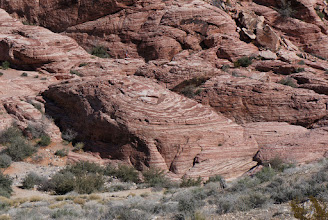 Photo: The great sandstone cliffs at Red Rock, thousands of feet high, are made up of the Aztec Sandstone.