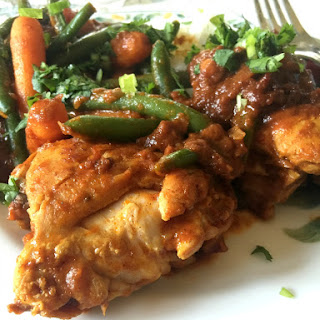 Braised Chicken Thighs With Spicy Tomato Sauce.