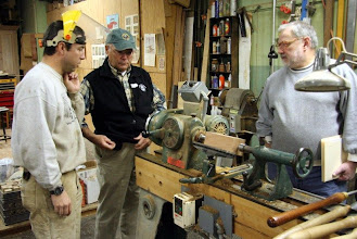 Photo: Bob and Mike look on as Joe sets up a spindle demo.