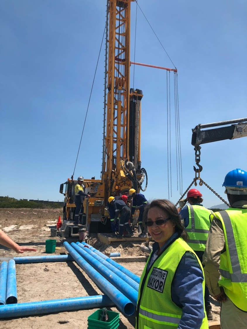 Cape Town mayor Patricia de Lille with a drill tapping the Cape Flats aquifer in Mitchells Plain.