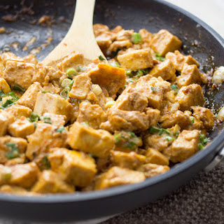 Spicy Tofu Skillet With Eggs And Scallions.