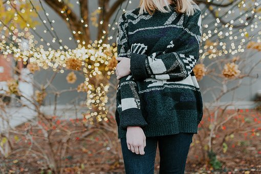 Woman dressed in a light sweater.