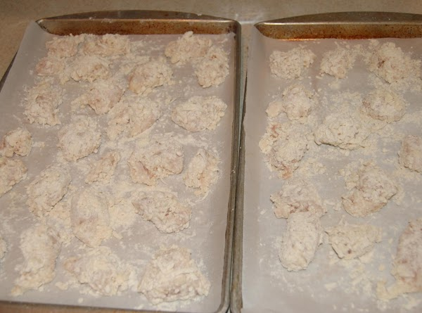 Place flour, panko, coconut and seasonings in plastic bag, mix well. Place chicken in...
