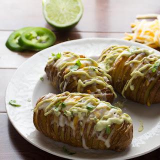 Cheesy Jalapeño Hasselback Potatoes with Creamy Avocado Sauce.