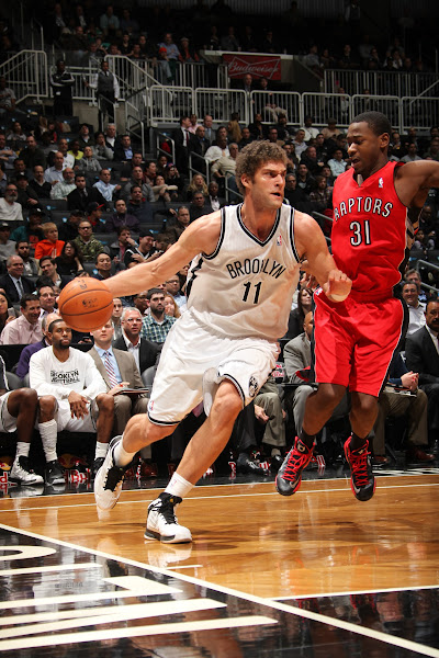 Photo: Brook Lopez #11 of the Brooklyn Nets drives to the basket against Terrence Ross #31 of the Toronto Raptors at the Barclays Center on January 15, 2013 in the Brooklyn borough of New York City in New York City.