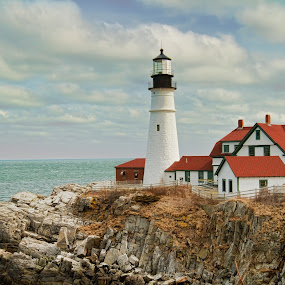 Portland Headlight Lighthouse by Kim Wilson - Travel Locations Landmarks ( clouds, picturesque, cliffs, portland, america, maine, colorful, exterior, green, headlight, lighthouse, travel, usa, landmark, americana, red, hyper realistic, blue, horizontal, outdoor, brown, day, outside )