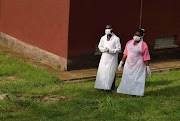Ugandan medical staff inspecting the ebola preparedness facilities at the Bwera general hospital near the border with the Democratic Republic of Congo in Bwera, Uganda on June 12, 2019.