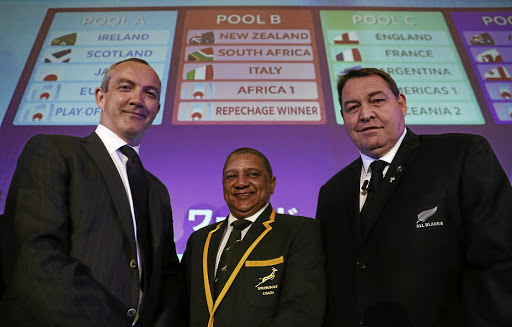 Springbok coach Allister Coetzee is flanked by Italy coach Conor O' Shea, left, and All Black coach Steve Hansen at the 2019 World Cup draw in Kyoto on Wednesday.Picture: REUTERS