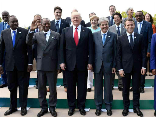 President Uhuru Kenyatta, Guinea's President Alpha Conde, US President Donald Trump, Italian Prime Minister Paolo Gentiloni, French President Emmanuel Macron, Niger's President Mahamadou Issoufou pose for a family photo with other participants of the G7 summit in Taormina, Sicily, Italy, May 27, 2017. /REUTERS