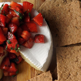 Warm Brie with Strawberry, Basil and Balsamic Salsa.