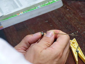 Photo: Stephan puts the final touches on a pearl that was just purchased.