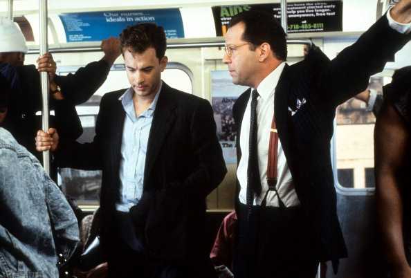 Tom Hanks and Bruce Willis riding the bus in a scene from the film 'The Bonfire of the Vanities', 1990