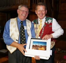 Photo: Speaker Professor Dewey Caron presented with his Peace Bridge Print by INIB President Bill Turnbull