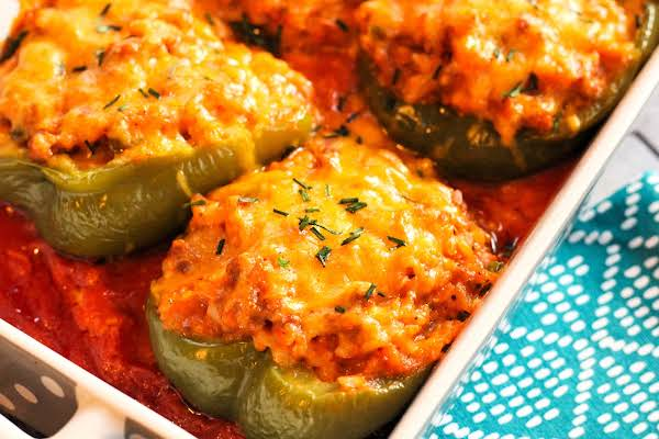 Italian Sausage And Rice Stuffed Peppers With Melted Cheese.