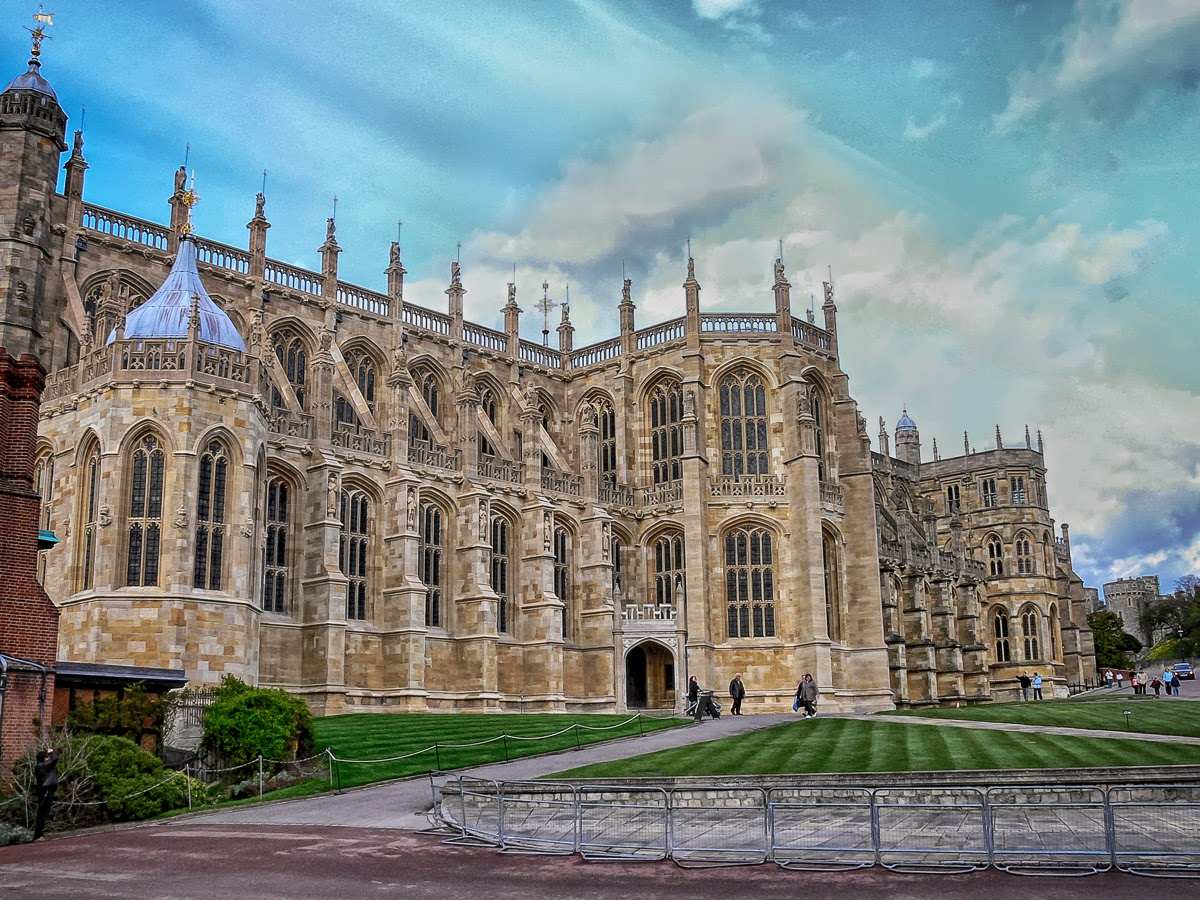 Photo: St. George's Chapel Who's buried there?  In April 2006 I visited Windsor Castle. In the lower ward sits . . . or rather, stands St. George's Chapel. The original chapel was constructed in 1348, and has been plundered, repaired, expanded and remodeled a number of times. In various corners throughout the building are buried several historical royal personages, most notably from the last century, King George VI, Princess Margaret and The Queen Mother.  This photo was taken with my Panasonic Lumix DMC-FZ30 camera before I knew any better about RAW vs. JPEG photos. My budget minded decision was to take a 1 GB SD card and stick with JPEG. There is a bit of Topaz, some NIK HDR Efex Pro 2, and . . . some other stuff.  #England  #travel  #WindsorCastle  #Windsor  #London