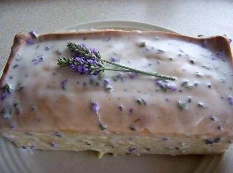 Grease a 9x5x3 inch loaf pan.   Preheat oven to 325 degrees. Heat milk with...