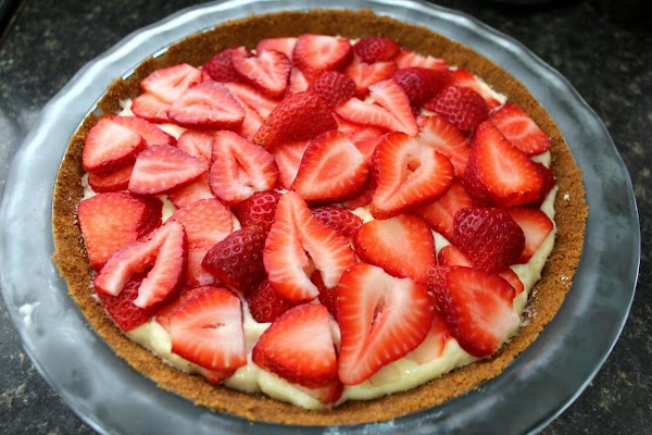 Mousse mixture poured into gingersnap crust with strawberries on top.