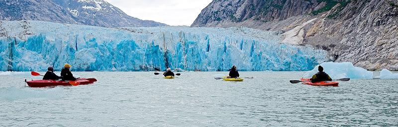 Kayaking near a glacier on our Safari Explorer trip to Alaska.