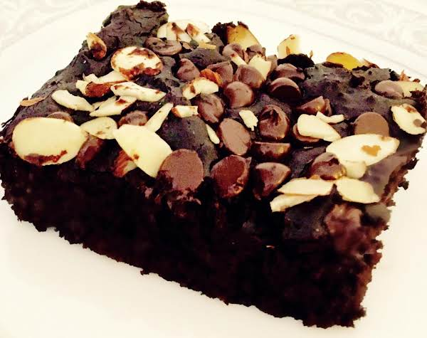 Brownie Shown Topped With Chocolate Chips And Sliced Almonds