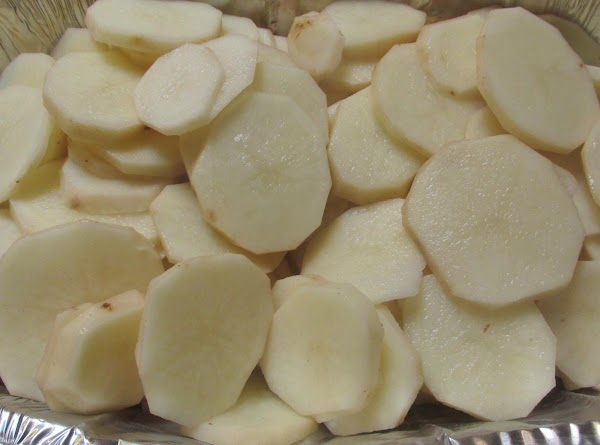 Slice or cube potatoes into desired size pieces.Then wash thourgly.