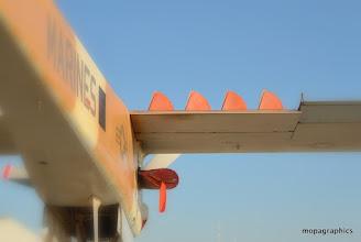 """Photo: Un North American OV10 """"Bronco"""", et ses turbulateurs escamotables, individuellement."""