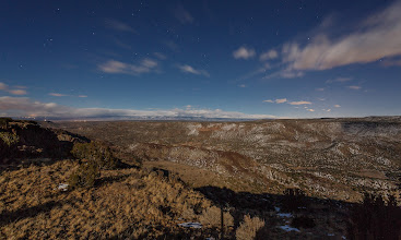Photo: A 30-second exposure taken by moonlight. Straight in the center of the frame is Santa Fe in the foothills of the Sangre de Cristo mountains. The lights on the left edge are Truchas, N.M. In the foreground is White Rock Canyon, where the Rio Grande flows east of Los Alamos.