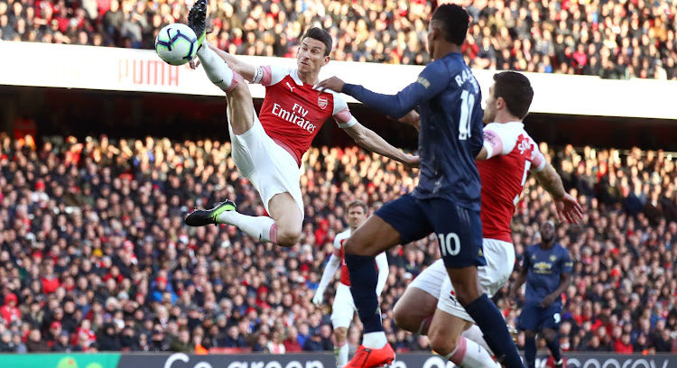 Arsenal came out on top as the Gunners beat Manchester United 2-0 to take an edge in the race for a top four place. Laurent Koscielny of Arsenal stretches for the ball during the Premier League match at Emirates Stadium on Sunday.