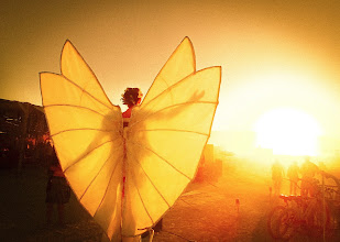 Photo: Angel in the Sun  One morning while visiting center camp at Burning Man, I saw this delicate angel on stilts gliding around the outside in the morning sun...