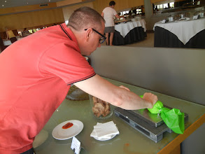 Photo: Our hotel featured do-it-yourself cannoli ... for breakfast. Here's Chris getting ready to stuff a cannoli.