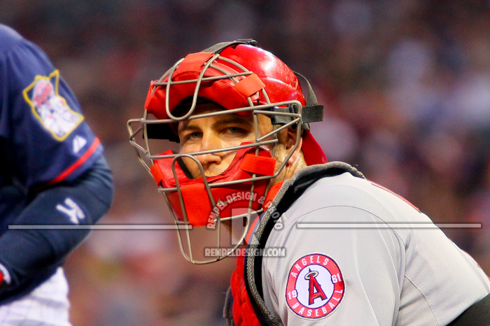 Photo: 11 April 2012: Los Angeles Angels catcher Chris Iannetta getting the signs from the dugout at Target Field in Minneapolis, MN
