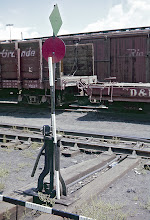 Photo: 078-08.  Typical switchstand in yards near water tank, with my measuring sticks for proportions.  7/28/60.