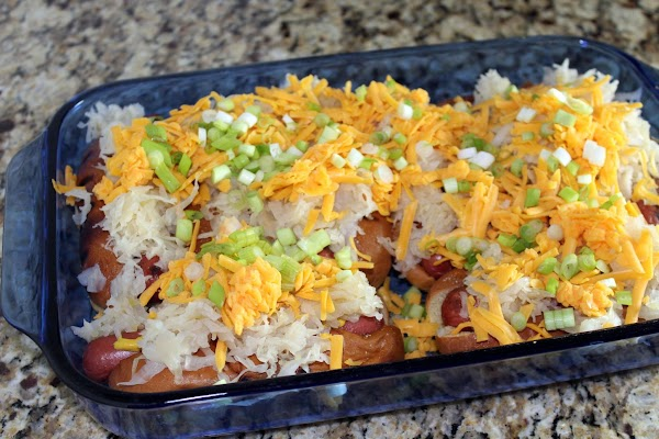 Top with cheese and green onions.
