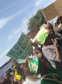 Community members protest at a previous court appearance of two men accused of the mass slaying of the Khoza family in Vlakfontein.