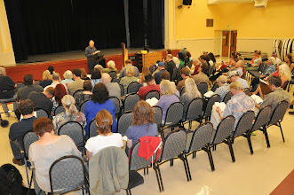 Photo: Michael Heavener reading his poetry to an attentive RASP audience.