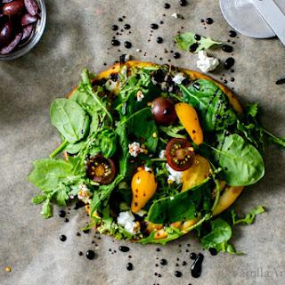 Flatbread Salad Pizza with Pesto, Shaved Asparagus, Mushrooms and Feta.