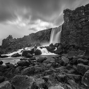 hypnotizing by Ruslan Stepanov - Black & White Landscapes ( clouds, water, iceland, nature, black and white, waterfall, long exposure, öxaráfoss, rocks, river )