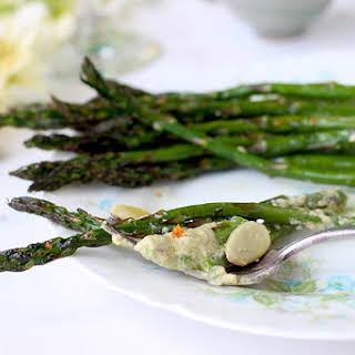 Roasted Asparagus topped with Fresh Pea Chevre Pesto and Mandarin Sea Salt.