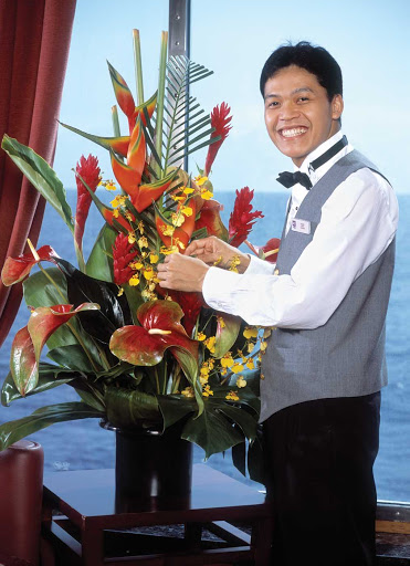 ncl_Haven_Butler.jpg - A butler prepares a floral arrangement in a suite in The Haven on Norwegian Cruise Line.