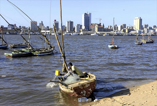 A fisherman bails out his boat in Maputo Bay. Mozambique, ravaged by decades of war, enjoyed several years of economic resurgence after the discovery of gas off the coast, but has again fallen on hard times.