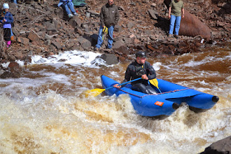 Photo: A boater in an inflatable raft makes his way down the Lester River.