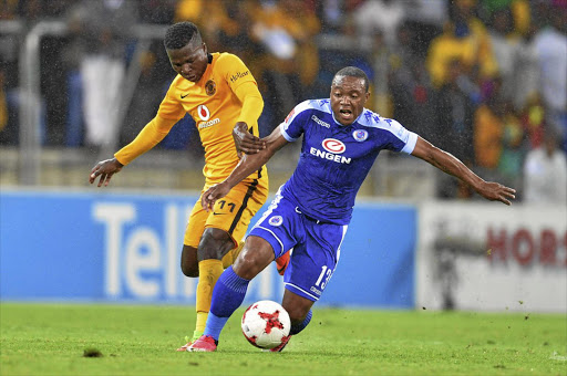 A file photo of former Kaizer Chiefs Zimbabwean striker Edmore Chirambadare (L) challenges Thuso Phala of SuperSport United for the ball during an Absa Premiership match.