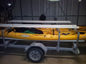 Photo: Side view showing the brackets holding the pipes on. Notice how the pipe bows slightly in the middle to support more of the kayak.