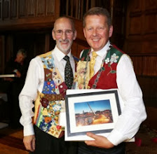 Photo: INIB President Bill Turnbull presented with his Peace Bridge Print by INIB Chairman Michael Young MBE