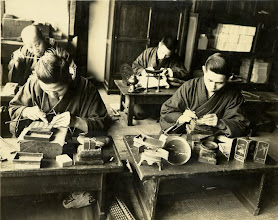 Photo: Workers at a shop making nunome-zogan items. Note the size of the hammer heads.