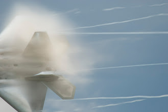 Photo: In the high humidity of the St Cloud afternoon, the F-22 Raptor generates lots of condensation trails.