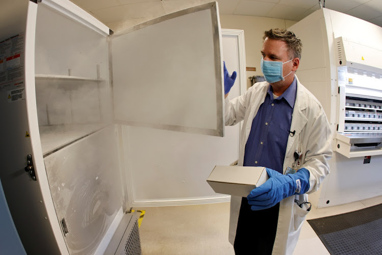 Pharmacy supervisor Kevin Weissman opens the door of a special freezer that will hold the Pfizer vaccine at LAC USC Medical Center in Los Angeles, California. Picture: REUTERS/Mike Blake