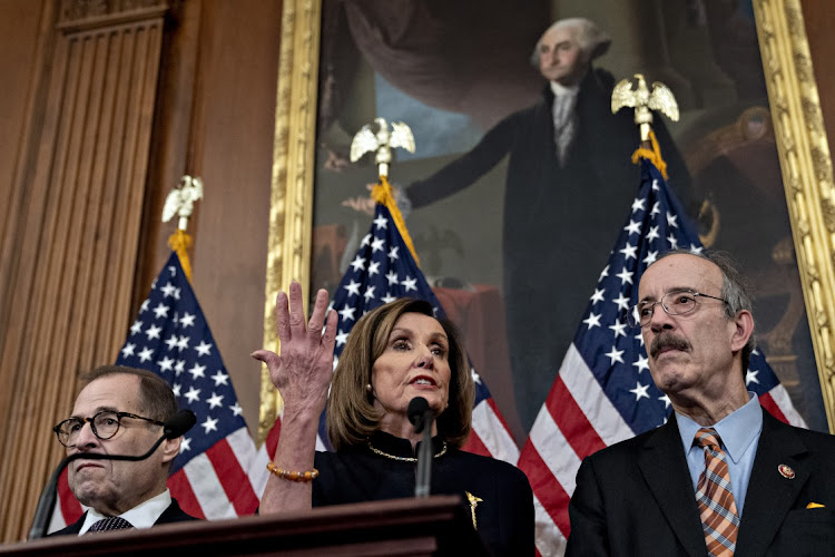 US House Speaker Nancy Pelosi, a Democrat from California, center, speaks as Representative Eliot Engel, a Democrat from New York and chairman of the House Foreign Affairs Committee, right, and Representative Jerry Nadler, a Democrat from New York and chairman of the House Judiciary Committee, listen during a news conference after the House voted on articles of impeachment against President Donald Trump on December 18 2019. Picture: BLOOMBERG/ ANDREW HARRER
